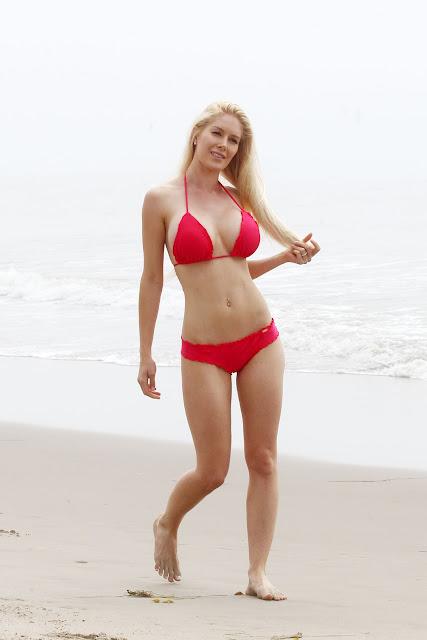 Heidi Montag shows off her curves in a bikini on a beach