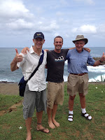 Mark Kirwin with Bo (Project WOO) and Ed (Ventura Rotary) in front of an ocean view.
