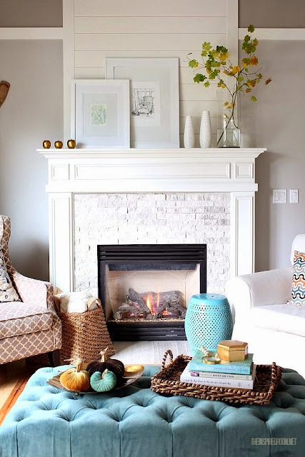 white mantle subway tile fireplace surround in living room