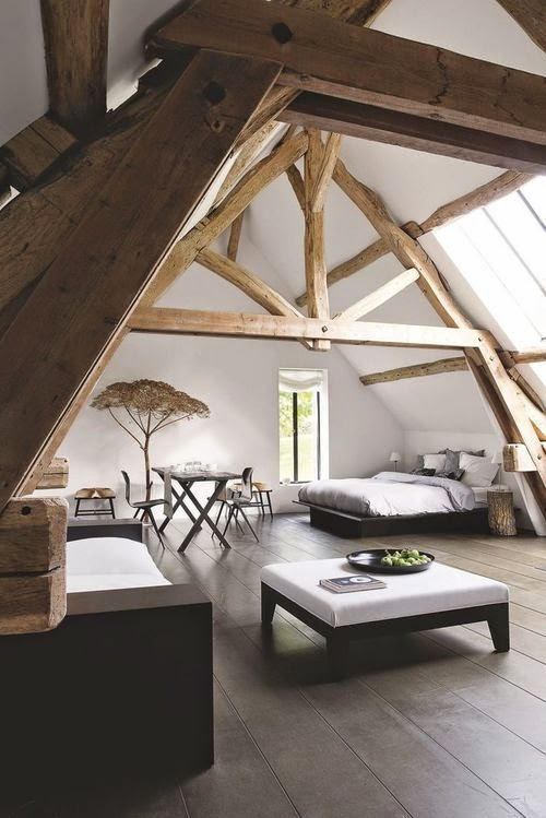 hand carved wooden beams in attic room