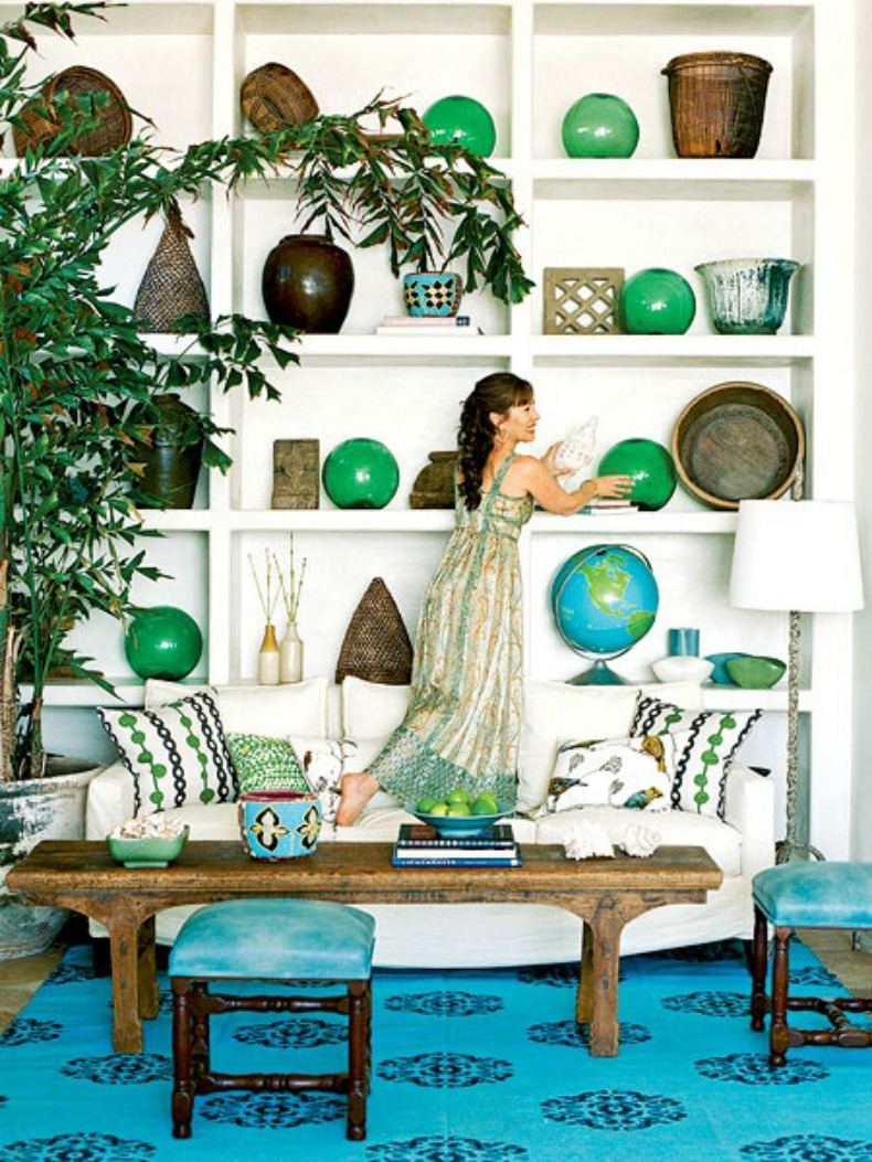 Large sea glass ball floats on a bookshelf for a coastal touch