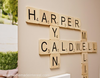 http://www.homemadeinterest.com/2014/07/14/family-wall-art-scrabble-edition/