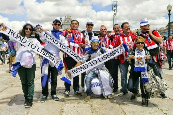 بالصور : جماهير الريال واتلتيكو مدريد يحتلان لشبونة