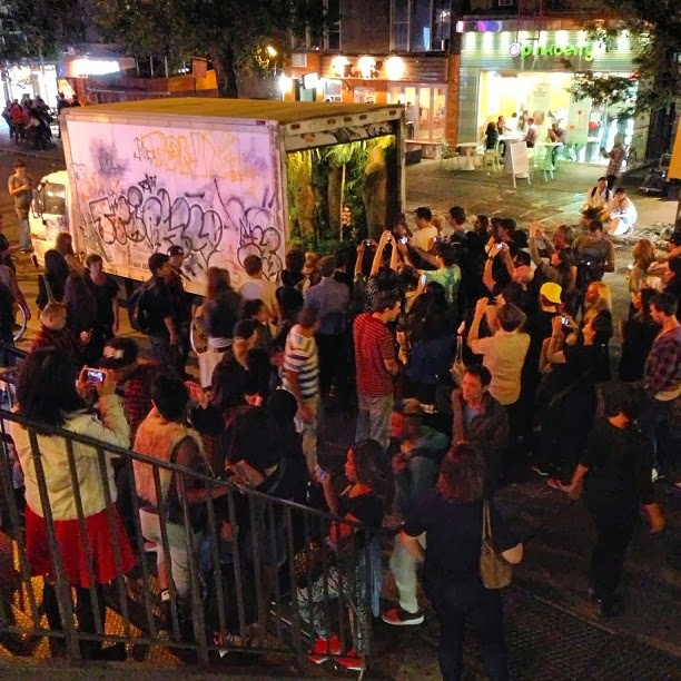 """All City"" Truck Installation By Banksy For Better Out Than In Exhibition In New York City.crowd"