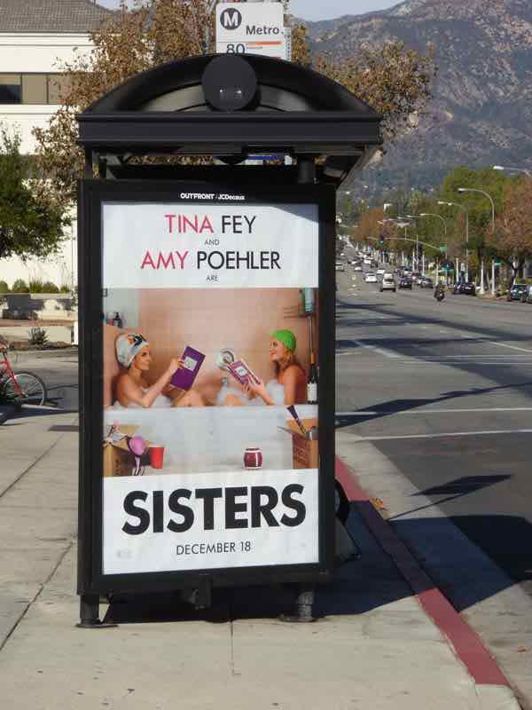 Tina Fey and Amy Poehler are Sisters, movie poster at a bus stop