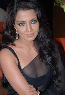 Celina Jaitley in black transparent saree showing her perfect assets