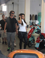 Kim Kardashian looking at motors at a Motorcycle Store