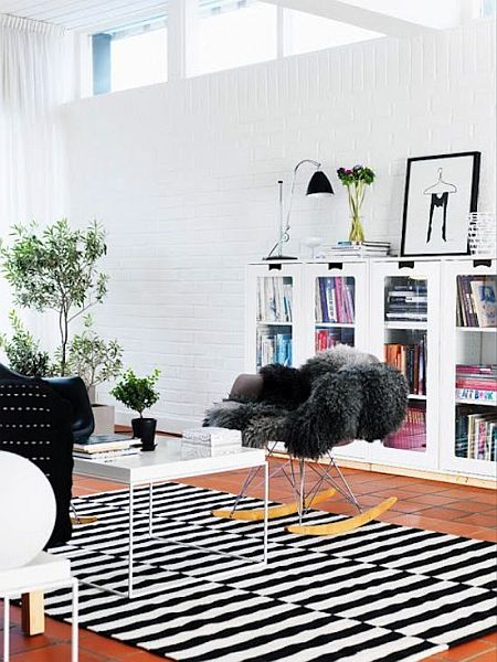 clear Swedish living room with black and white striped rugs