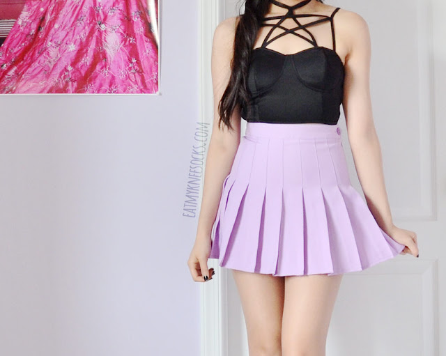 A cute, edgy, Harajuku and punk-inspired outfit featuring a lilac purple pleated American Apparel tennis skirt dupe from Miuxin and the strappy black pentagram cropped bralet/bustier top from Brandedkitty Shop, paired with spiked Jeffrey Campbell Lita platform dupes.