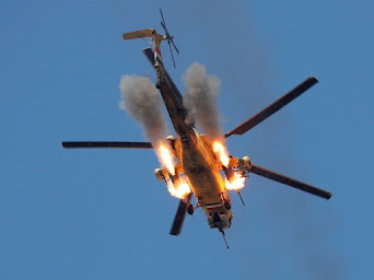 An Iraqi Airforce helicopter fires missiles at Islamic State fighters  - Mosul, Iraq