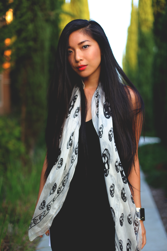 Stephanie Liu of Honey & Silk wearing LAST NIGHT Principal Dress, Alexander McQueen scull scarf, CC SKYE enamel cuff, and Growze shoes