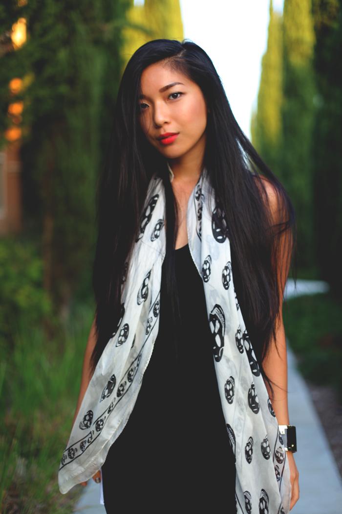 Stephanie Liu of Honey & Silk wearing LAST NIGHT Principal Dress, Alexander McQueen scull scarf, CC SKYE enamel cuff, and Growze shoes