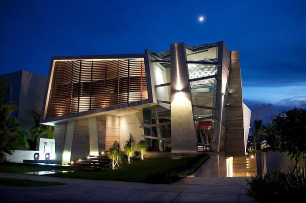Desain Rumah Modern Abstrak Dengan Pencahayaan Unik