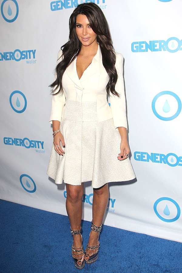 Kim Kardashian is armed and dangerous with killer spiky heels at the 4th annual Night of Generosity Gala in LA.
