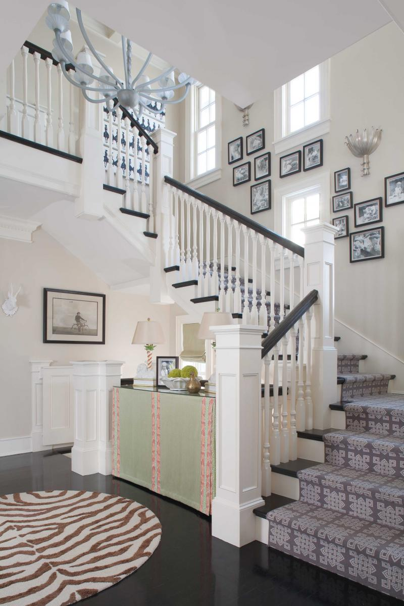Stairway photo walls through the front door for Classic foyer design
