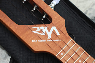 Risa Uke Solid ukulele logo