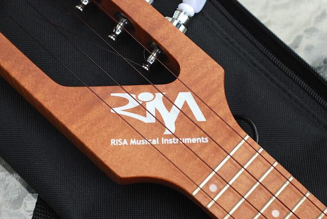 Risa Uke Solid ukulele logo