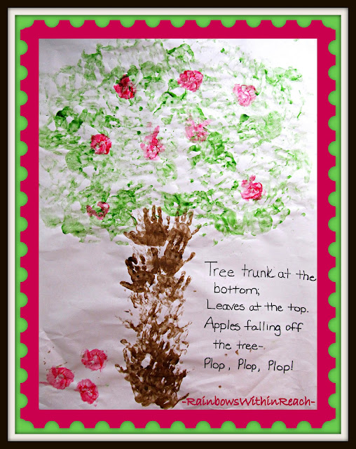 photo of: Back to School Bulletin Board on Apple Theme: Cooperative Art Project with Painted Handprints and Rhyme