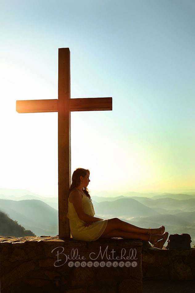 senior girl with cross and mountains