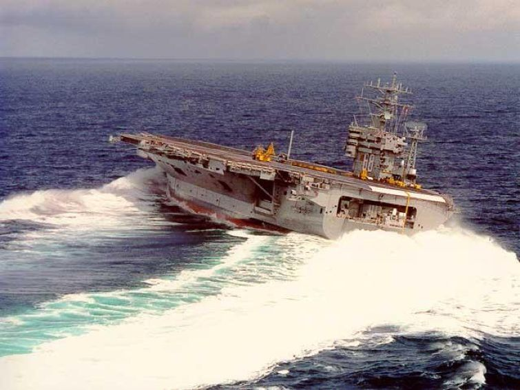 aircraft-carrier-tips-as-it-makes-sharp-