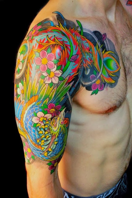 Colourful phoenix tattoo on arm and chest