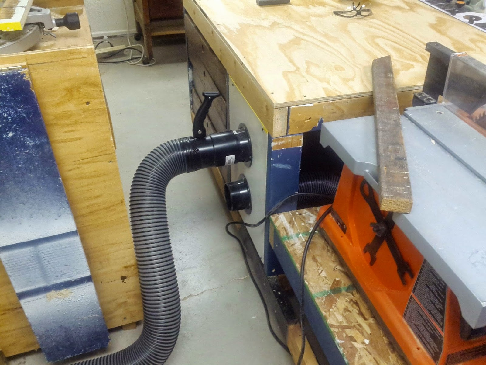 this next picture is the router station built into the table saw outfeed table my dad needs to build a new fence for the router but with the dust