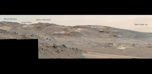 "This April 16, 2015, panorama from the Mast Camera on NASA's Curiosity Mars rover shows a detailed view toward two areas on lower Mount Sharp chosen for close-up inspection in subsequent weeks: ""Mount Shields"" and ""Logan Pass."" Credits: NASA/JPL-Caltech/MSSS"
