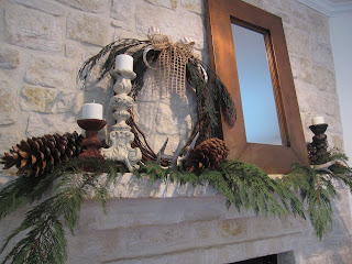 Rustic Christmas fireplace mantle with wreath and antlers