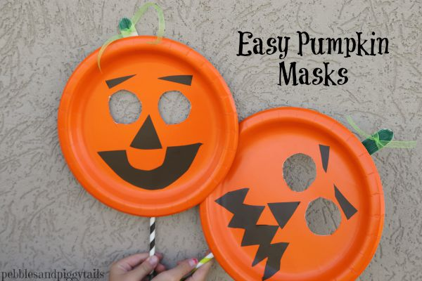 Tape a the straw on the bottom half of the mask to make easy holding for little hands. & Easy Paper Plate Pumpkin Mask Craft   Making Life Blissful