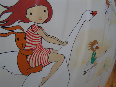A close up image of a girl and ted riding on a swan, image part of the willowandme.co.uk swan sculture
