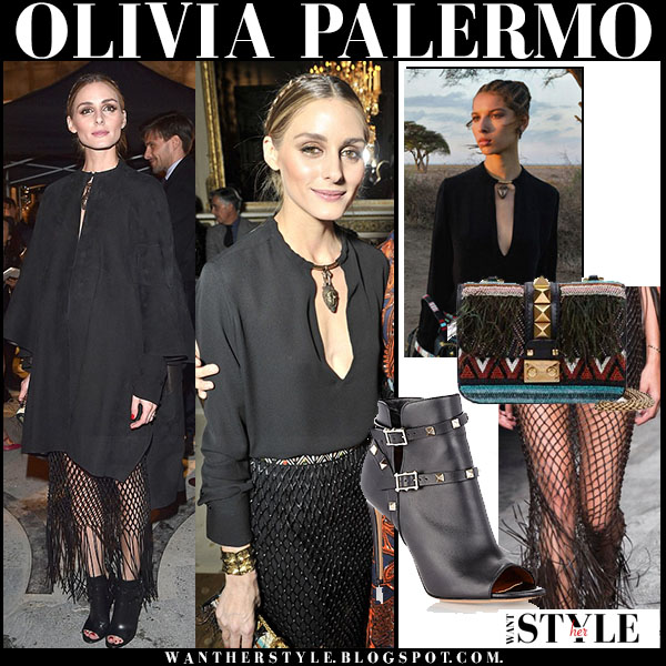 Olivia Palermo in black Valentino cape, black Valentino blouse, black mesh fringe Valentino skirt and open toe ankle boots valentino rockstud what she wore front row