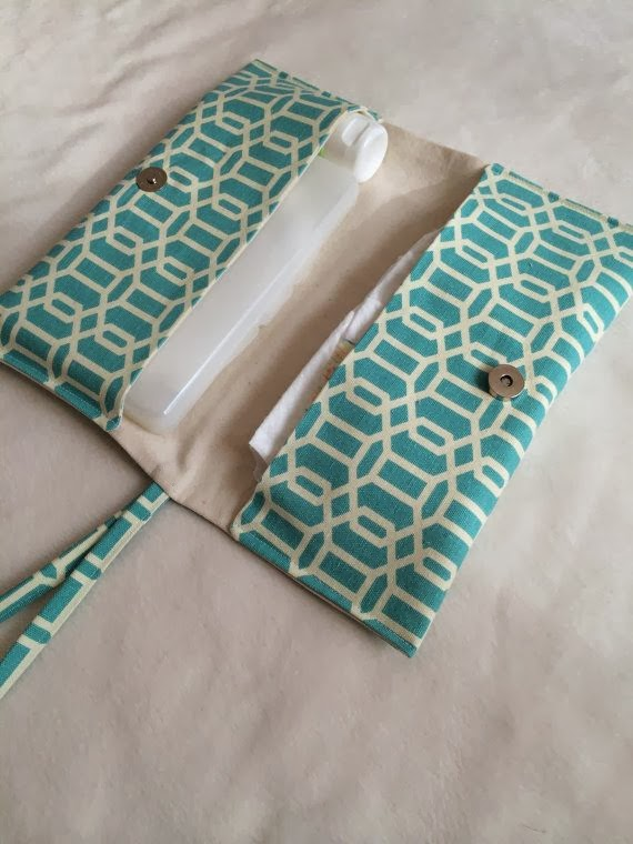 http://www.etsy.com/listing/178957621/two-pocket-diaper-clutch