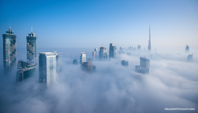 Photo of Downtown Dubai and its skyscrapers above the low fog
