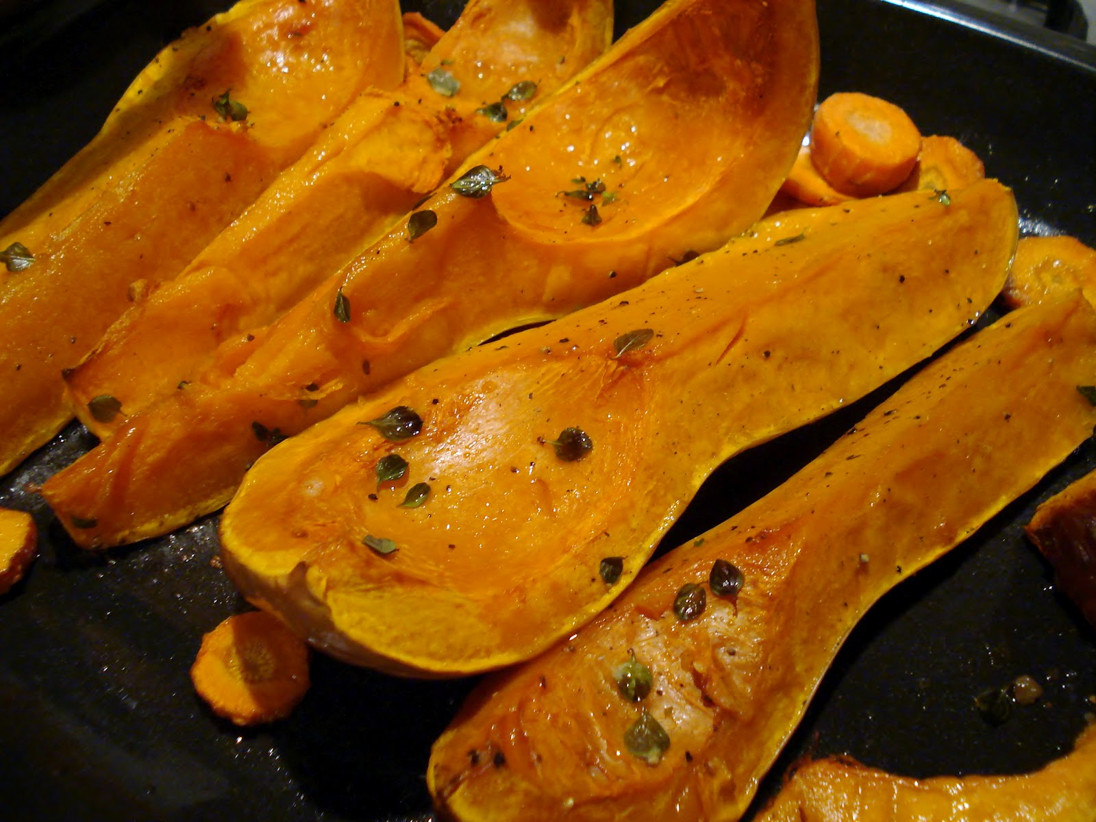 Peel off the skin and add the roasted squash and the herbs to the pan.