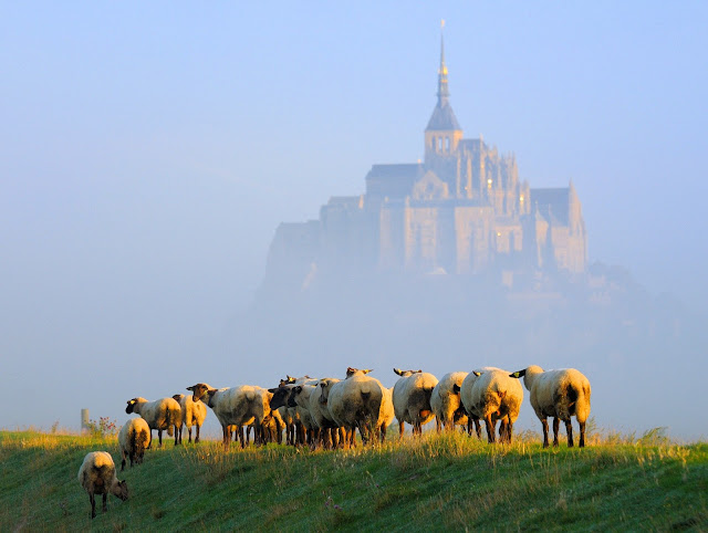 Rising from the tidal flats in Normandy, Mont Saint-Michel appears to float in the mist on the horizon. Photo: WikiMedia.org.