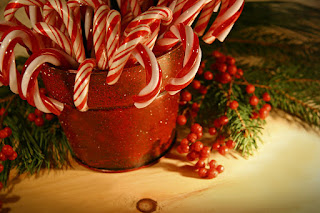 candy canes in a jar, christmas decorations with a history of the candy cane and how a candy cane tradition got started