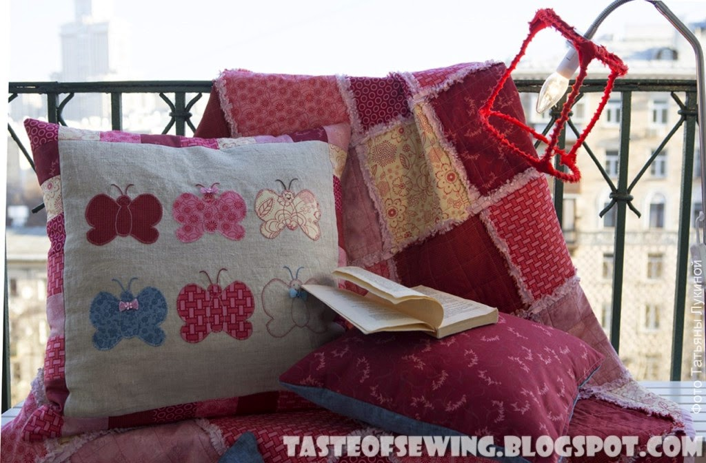 pink and raspberry rag quilt and pillows
