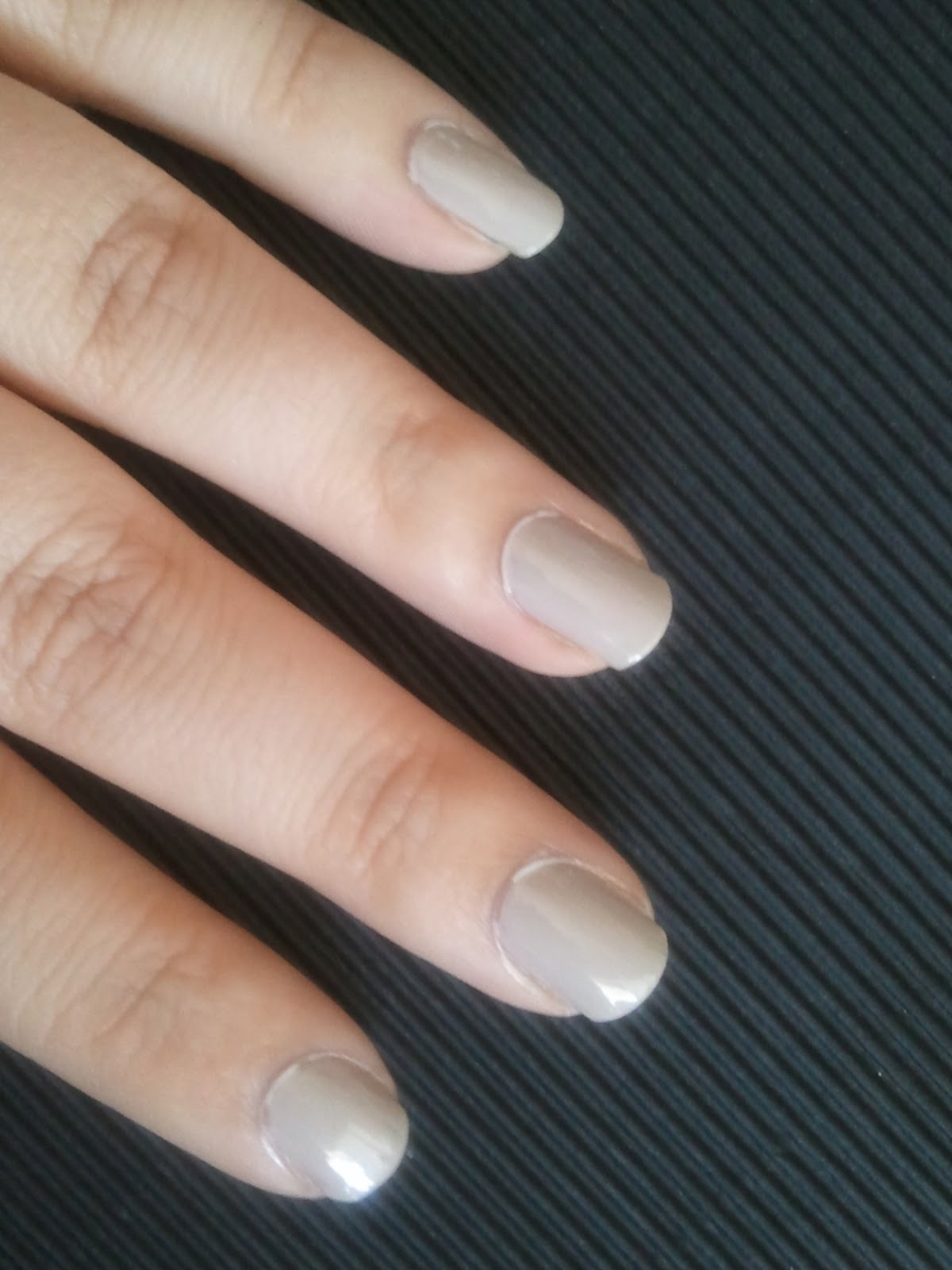Start with a light tan color as the base Camo Nail Art Tutorial