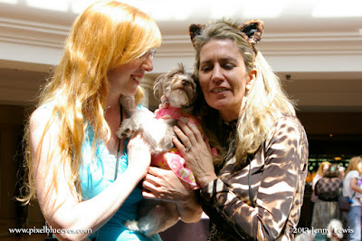 Pixel Blue Eyes being held by Mom Jenny Lewis and hugged by Deborah Barnes at BlogPaws 2013