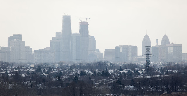 Photo of towers under construction and the skyline