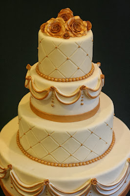 gold wedding cake with roses