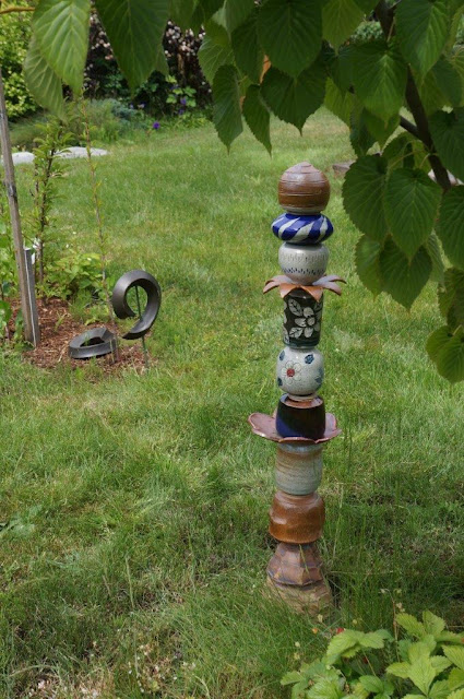 Handmade ceramic pottery garden totem in my garden.