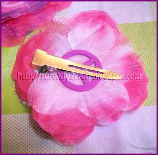 luau flower petals attached to hair clip