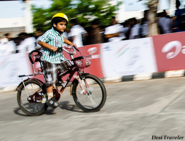 boy with helmet on cycle