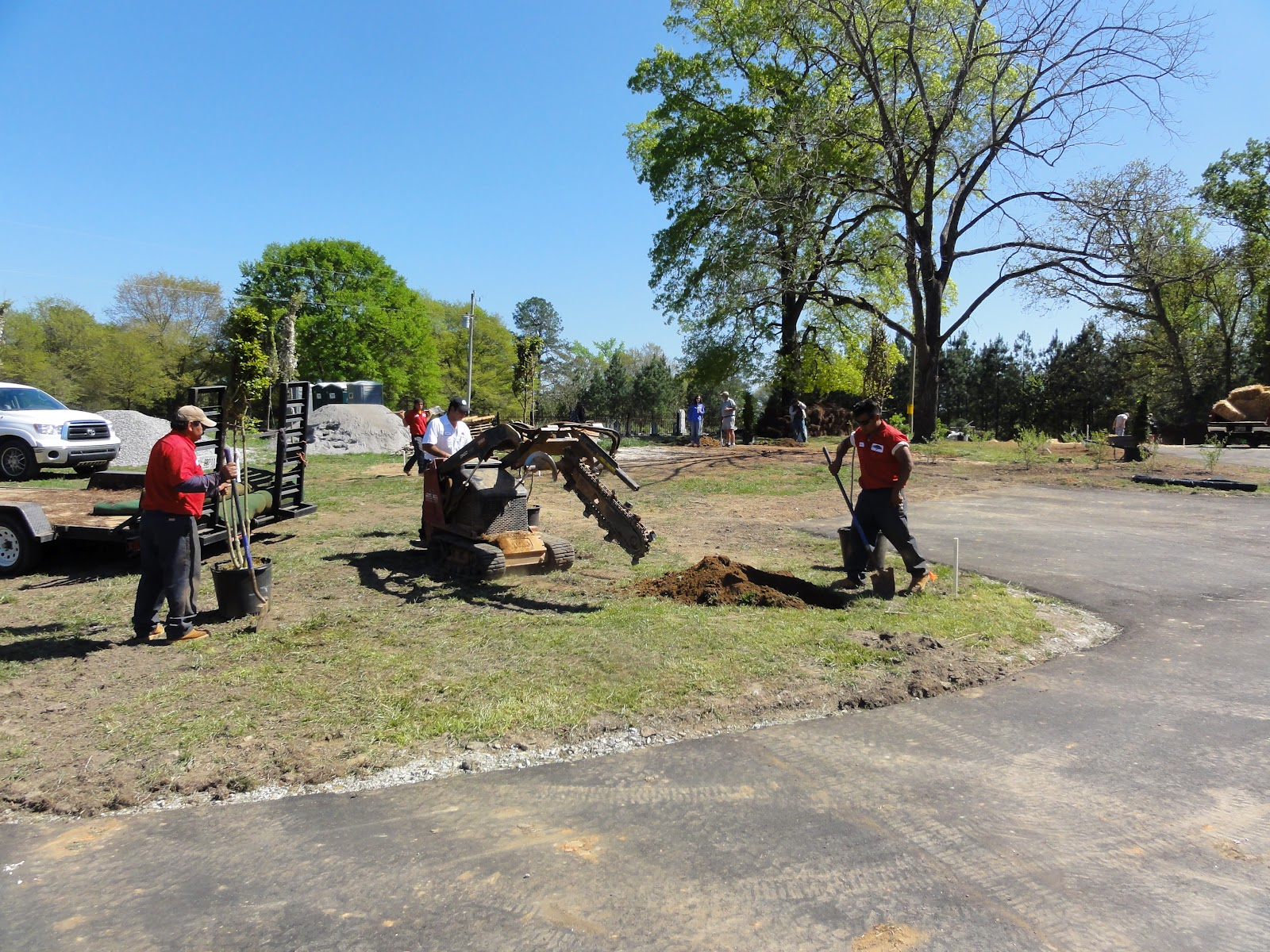 College Pro Landscaping Helping To Dig Holes For The Trees To Be Planted