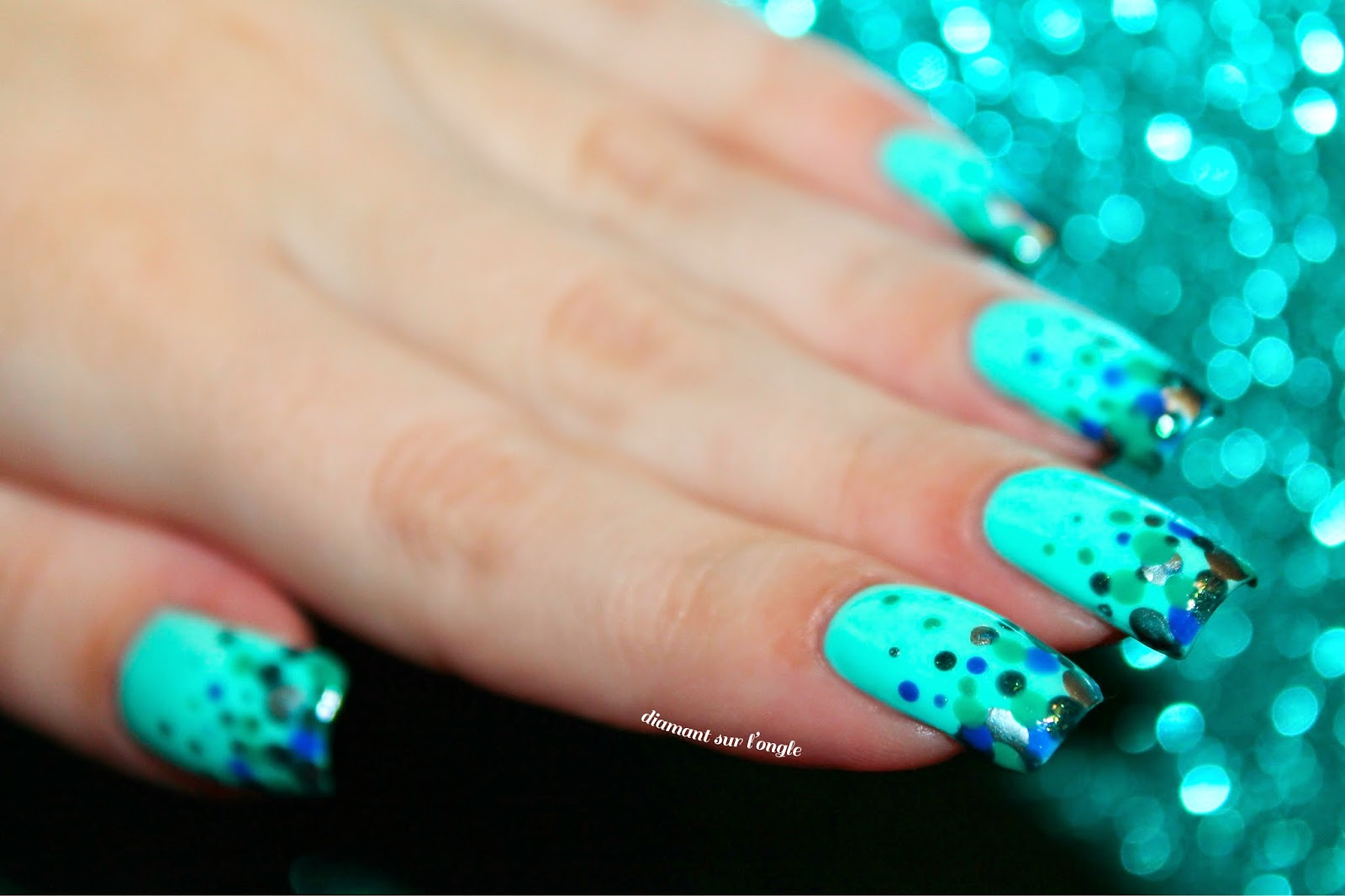 A mermaid french manicure made with a dotting tool
