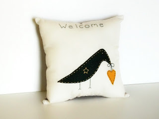 crow stitchery pillow