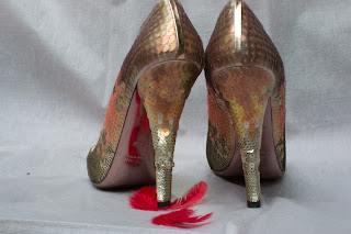 Sequinned pink Miu Miu shoes with red feathers