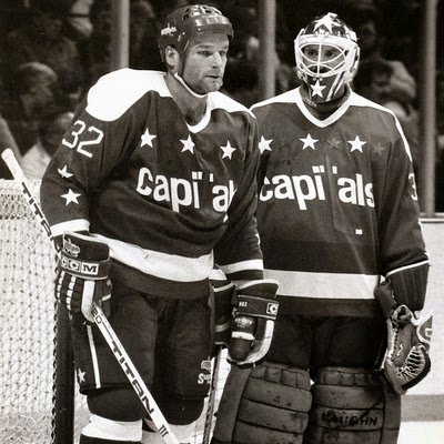 All Caps:  Dale Hunter gets to pose with goalie Clint Malarchuk...
