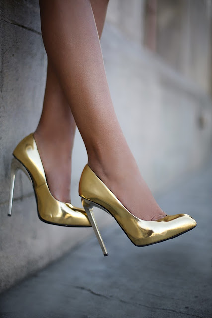 Golden high heel shoes